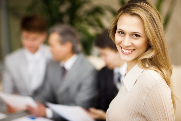 Portrait of young confident business woman smiling