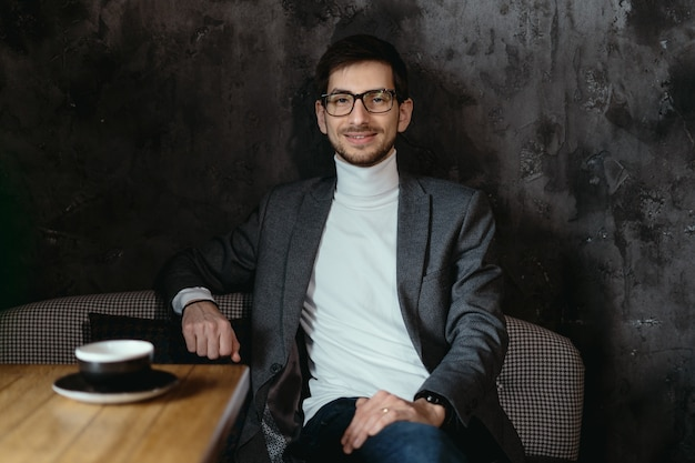 Portrait young, confident businessman wearing glasses