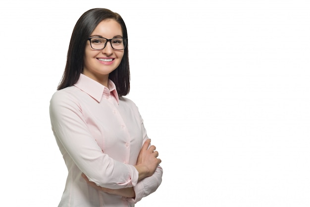 Portrait of young confident smiling woman in glasses with folded hands