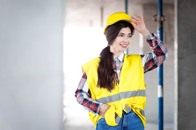 Portrait of young construction woman