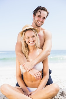 Portrait of young couple embracing on the beach