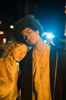 Portrait of young couple going out at night