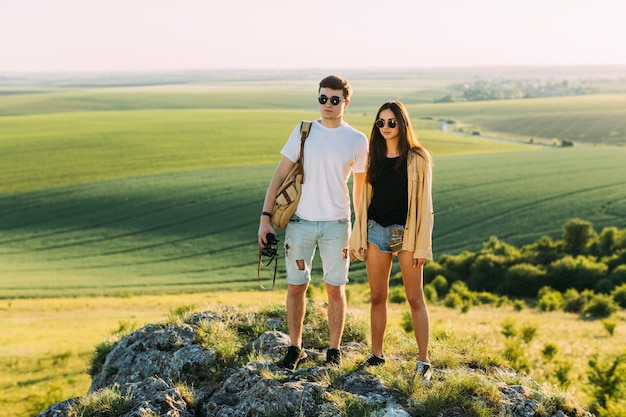 Portrait of a young couple standing on rock