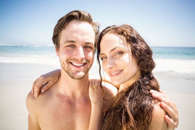 Portrait of young couple together on the beach