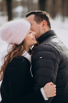 Portrait of a young couple together in winter on valentines day