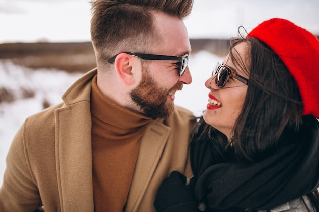 Portrait of young couple in winter park