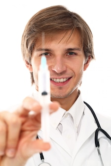 Portrait of young doctor man with syringe