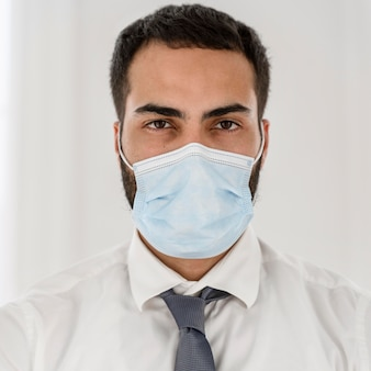 Portrait of young doctor wearing a medical mask