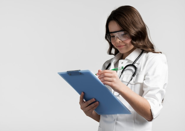 Portrait of young doctor writing medical form