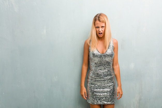 Portrait of young elegant blonde woman very angry and upset, very tense