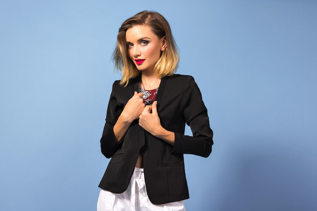 Portrait of young elegant woman with bright make up and dark blazer