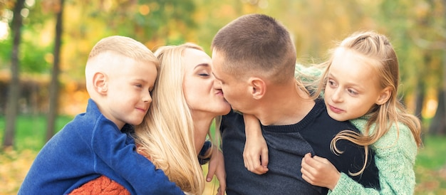 Portrait of young family in autumn park