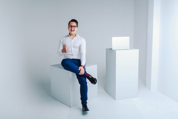 Portrait of a young fashionable guy in a white shirt