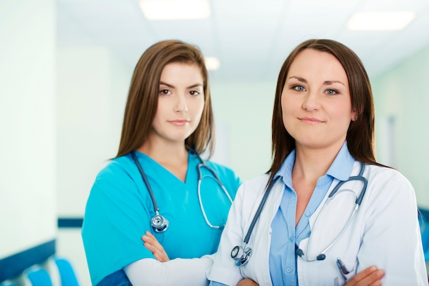Portrait of young female doctor with intern