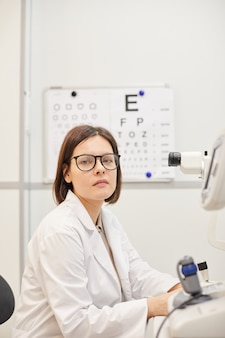 Portrait of young female ophthalmologist looking at camera
