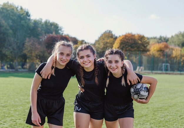 Portrait of young female rugby players