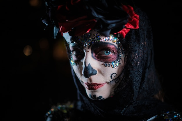 Portrait of a young female in the style of mexican holiday day of the dead
