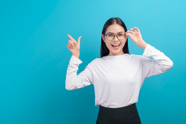 A portrait of young female wearing glasses over blue , healthcare concept