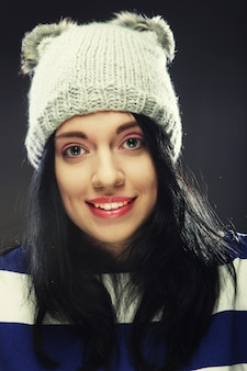 Portrait of young funny woman, wearing hat.