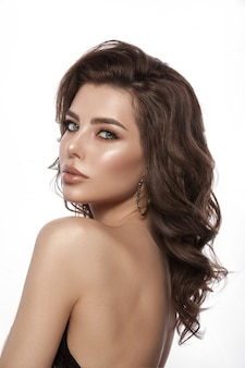 Portrait of a young girl. beautiful healthy hair, hair curls, natural make-up and lip color, glamorous image. isolated