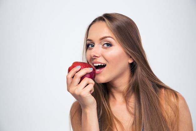 Portrait of a young girl biting apple