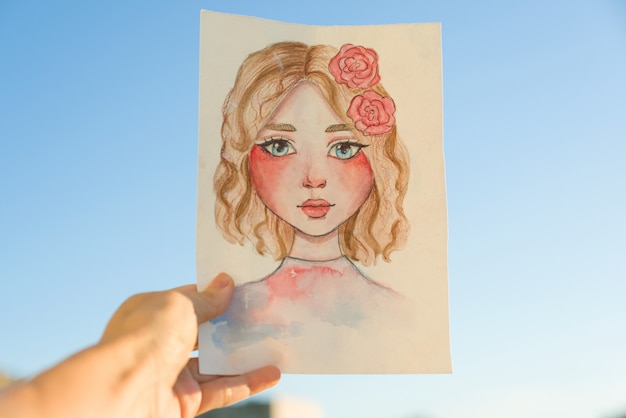 Portrait of young girl drawn by hand in watercolor and pencil.
