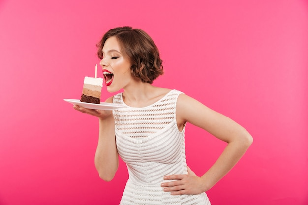 Portrait of a young girl eating a piece of cake