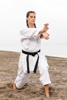 Portrait of young girl exercising karate