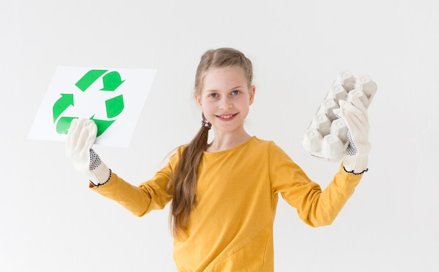 Portrait of young girl happy to recycle
