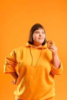 Portrait of young girl holding a doughnut