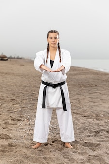Portrait of young girl in karate outfit