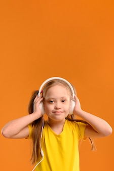 Portrait of young girl listening to music