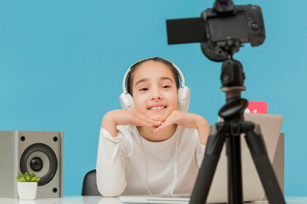 Portrait of young girl recording herself