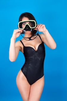 Portrait of a young girl in a swimsuit with a diving mask