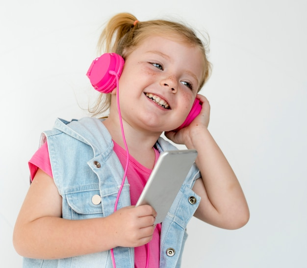Portrait of a young girl with headphones