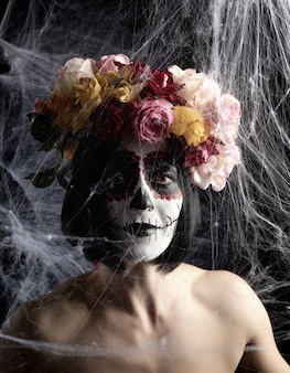Portrait of a young girl with makeup in the image of katrina for the holiday of the day of the dead.