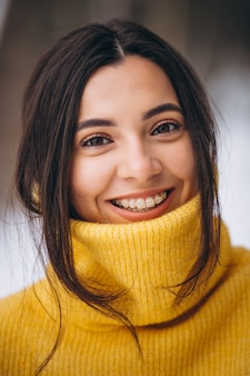 Portrait of a young girl in a yellow sweater