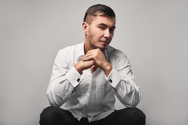 Portrait of young glamour handsome man in studio