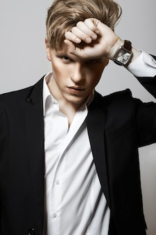 Portrait of young glamour handsome man in suit