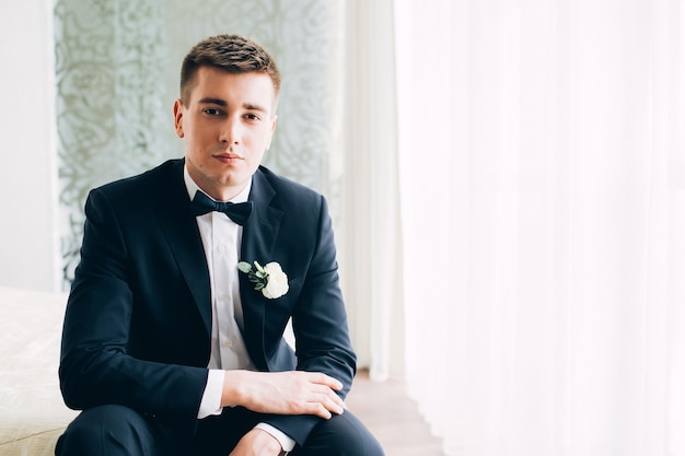 Portrait of a young groom posing