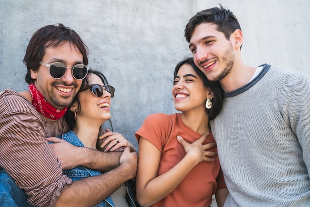 Portrait of young group of friends spending good time together and having fun outdoors. lifestyle and friendship concept.