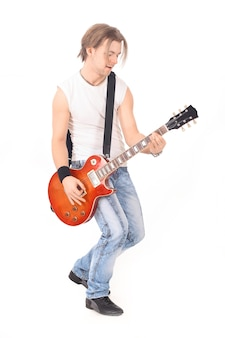 Portrait a young guy with a guitar. isolated on white