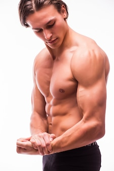 Portrait of young handsome athletic man with perfect abs undressing