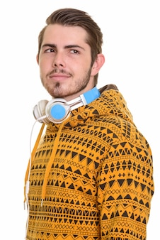 Portrait of young handsome bearded man with headphones