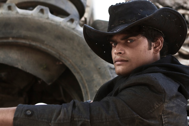 Portrait of a young handsome cowboy