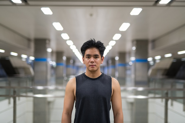 Portrait of young handsome filipino man in the city of bangkok, thailand
