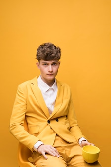 Portrait of young handsome man in a yellow scene
