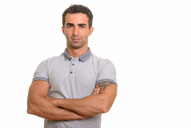 Portrait of young handsome persian man against white wall
