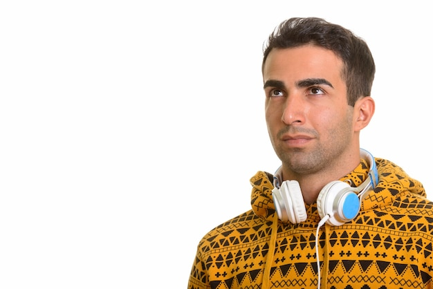 Portrait of young handsome persian man with headphones