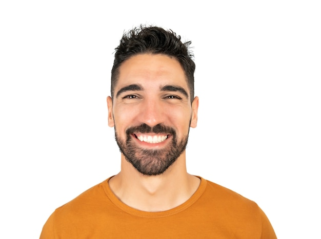 Portrait of young happy man smiling against white background